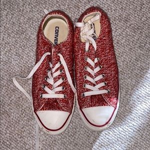 Red and white low top Converse with sewed outside